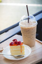 Peace of cherry cake serve with ice coffee Royalty Free Stock Photo