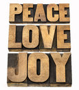 Peace love and joy in wood type word abstract a collage of isolated text letterpress Royalty Free Stock Images