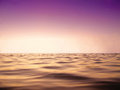 Peace sea and purple sky in sun set time close up as background Royalty Free Stock Photo