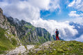 Peace and serenity man admiring the view from the edge of a cliff in the mountains romania Stock Photography