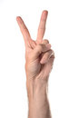 Peace sign hand closeup of a caucasian giving the Stock Image