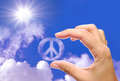 Peace sign hand embracing a cloud symbol Royalty Free Stock Photography