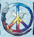 Peace symbol is painted on grunge wall