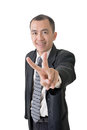 Peace or victory sign mature businessman give you a gesture of closeup portrait on white background Stock Photo