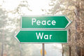 Peace or war signpost on two sides Royalty Free Stock Photo