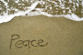 Peace written in sand the Stock Image