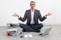 Peaceful entrepreneur practicing yoga on the office floor zen business concept of sitting crossed legs seeking for inspiration Royalty Free Stock Photography