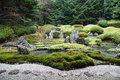 Peaceful Japanese Zen Garden with Pond, Rocks, Gravel and Moss Royalty Free Stock Photo