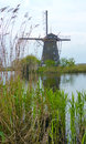 Peaceful landscape windmill kinderdijk netherlands Royalty Free Stock Image