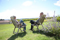 Peaceful in long chairs senior people relaxing countryside Royalty Free Stock Photography