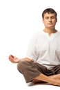Peaceful man meditating isolated over white doing yoga and a background Stock Images