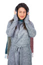 Peaceful model wearing winter clothes listening to music while posing on white background Royalty Free Stock Photos