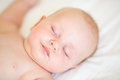 Peaceful newborn baby lying on a bed sleeping Royalty Free Stock Photo