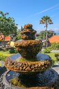 Peaceful scenery with fountain. Park near the Hindu Temple Tanah Lot, Bali, Indonesia. Small decorative fountain in tropical Royalty Free Stock Photo
