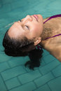 Peaceful woman floating in the pool Royalty Free Stock Photo