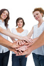 Peaceful women joining hands in a circle on white background Stock Photography