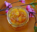 Peach apricot nectarine jam in a jar on the table Royalty Free Stock Photography