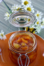 Peach apricot nectarine jam in a jar on the table Royalty Free Stock Photos