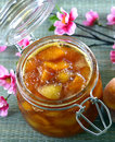 Peach apricot nectarine jam in a jar on the table Royalty Free Stock Image