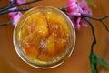 Peach apricot nectarine jam in a jar on the table Stock Photos