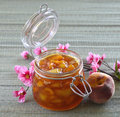 Peach apricot nectarine jam in a jar on the table Stock Image