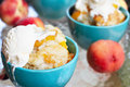 Peach cobbler and vanilla ice cream fresh served with Stock Image