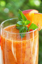 Peach cocktail with mint leaves Stock Images