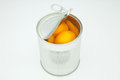 Peach in conserve a silver canister Stock Images
