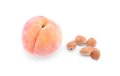 Peach with core isolated on white ripe a background Royalty Free Stock Photography