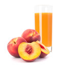 Peach fruit juice in glass isolated on white background cutout Royalty Free Stock Images