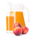 Peach fruit juice in glass jug Royalty Free Stock Photos