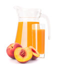 Peach fruit juice in glass jug isolated on white background cutout Royalty Free Stock Photography