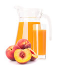 Peach fruit juice in glass jug isolated on white background cutout Stock Photography