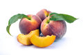 Peach and a half and leaves Royalty Free Stock Photo