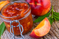 Peach jam with fresh fruits Royalty Free Stock Photography
