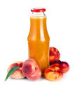 Peach juice in a bottle and fruit on white Stock Images