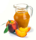 Peach juice and fruit in a jug a glass of Stock Photography