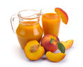 Peach juice and fruit in a jug a glass of Royalty Free Stock Photography