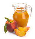 Peach juice and fruit in a jug a glass of Stock Photo