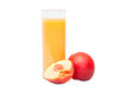 Peach juice the glass of with ripe near Royalty Free Stock Photo