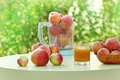 Peach juice and peaches on a table Stock Image
