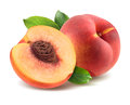 Peach with leaves and half piece isolated on white background Royalty Free Stock Photo