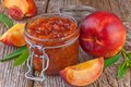 Peach or nectarine jam on wooden background Stock Image