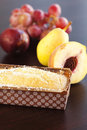 Peach, pear, plum, coconut cake and grapes Royalty Free Stock Image