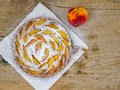 Peach pie on a wooden desk background Royalty Free Stock Photos