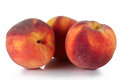 Peach three of juicy on a white background Royalty Free Stock Photo