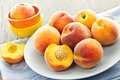 Peaches on plate Stock Images