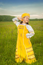 Peahen dance in the field in an elegant russian sundress Stock Photography