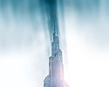 Peak of burj khalifa in sunbeams in dubai uae united arab emirates december it is tallest structure world since metres august Stock Images