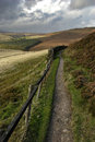 Peak district path leading to distant mountain in the Stock Photography